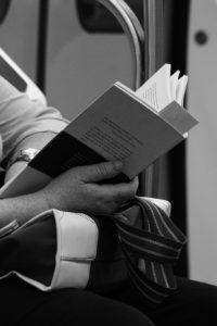 commute-passenger-reading-book